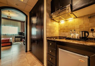 Photo 2 - First Central Hotel Suites