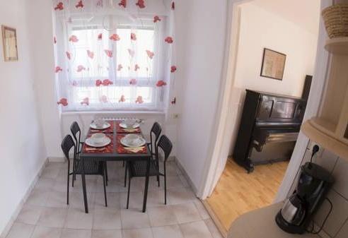 Foto 6 - Ebony Pianino Apartment