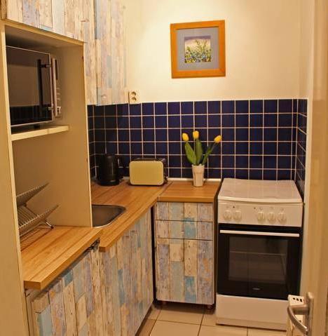 Foto 1 - Mohinga Apartment