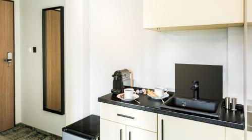 Foto 7 - Camera Apartments