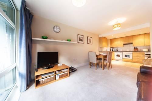 Foto 12 - Riverside Apartment