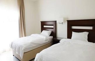 Photo 1 - Unique Suites