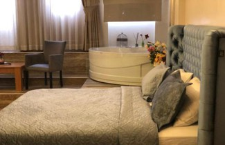 Foto 1 - Aiza Suites